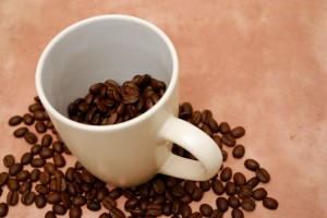 Organic coffee: Coffee beans and cup courtesy Dreamstime