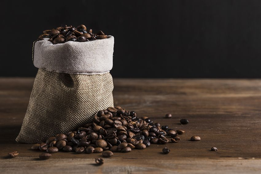 coffee sack with loose coffee beans beside